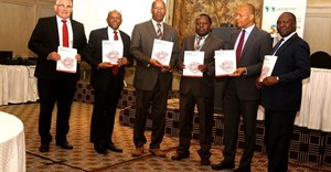 Unveiling the Zimbabwe Economic Report: (L-R) Malcolm Pautz, G:ENESIS Analytics; Damoni Kitabire country manager COZW; Zvinechimure R. Churu, principal director Ministry of Finance and Economic Development; Walter Odero, principal country economist COZW; Ferdinand Bakoup, Ag. director ECCE; and George A. Kararach, lead economist RDGS.