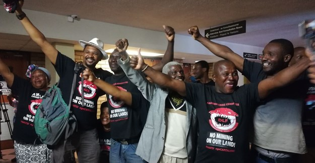 Xolobeni community members celebrated at the North Gauteng High Court after Judge Annali Basson ruled that the Department of Mineral Resources has to obtain consent from mining communities before granting a mining right to a company. Photo:Zoe Postman