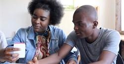 Orelie Kabeya and Exauce Kabeya with Wikifundi 2.0. Photographer: Isla Haddow-Flood.