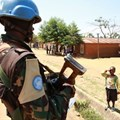 A Congolese child saluting a MONUSCO peacekeeper. Abel Kavanagh/Wikimedia Commons, CC BY-SA