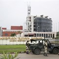 Gabonese soldiers stand in front of the headquarters of the national broadcaster in Libreville on January 7, 2019, after a failed coup. Gabon shut down the internet and broadcasting services following the coup attempt. Credit: CPJ/AFP/Steve Jordan.