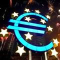 Fireworks illuminate the sky around a huge euro sculpture. Reuters/Kai Pfaffenbach