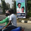 A campaign poster for Nigeria's incumbent president and candidate Muhammadu Buhari and his Vice-President Yemi Osinbajo, pictured in Lagos, on January 4. Credit: AFP/Pius Utomi Ekpei. Source: Committee to Protect Journalists (CPJ).