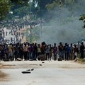 Protesters block the main route to Zimbabwe's capital Harare from Epworth township on January 14, 2019, after the government more than doubled the price of fuel. On January 15, CPJ joined more than 20 rights organizations and the #KeepItOn Coalition to call for authorities in Zimbabwe to restore internet and social media services. Credit: CPJ/AFP/Jekesai Njikizana.