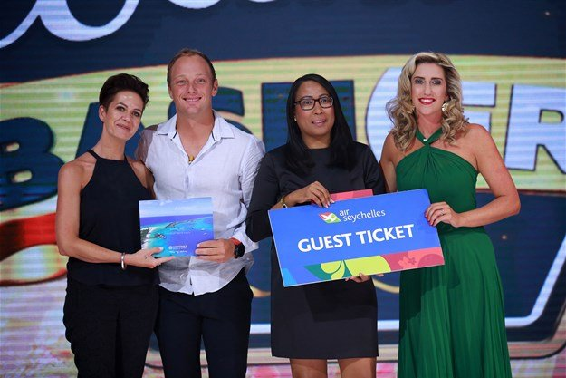 Michelle Damaskinos from Constance Hotels & Resorts and Lena Hoareau from the Seychelles Tourism Board awarding the prize to the winning couple, Megan and Jason from East London during the finale of the show.
