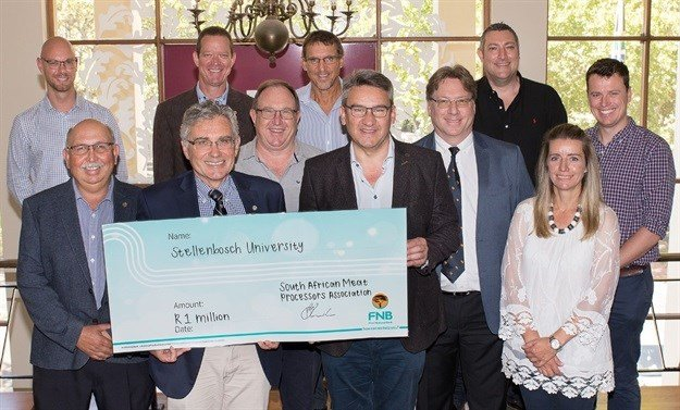 A donation of R1m was handed over to the vice-chancellor of Stellenbosch University, Prof Wim de Villiers (front row, second from left), by executive committee members of the South African Meat Processors Association. It will further the work done by the Centre for Food Safety, led by Prof Pieter Gouws (front, left). The SAMPRA members attending were (left, back row) Wesley de Jager, Bruce Smit (second from the right, back row), Alistair Hayward (right, back row), and (front) Arnold Prinsloo, Peter Gordon (chief executive officer: SAMPA), Andrew Cocks (president: SAMPA) and Melindi Wyma. With them are (back row) Prof Gunnar Sigge (chair: SU Department of Food Sciences), Prof Danie Brink (dean: SU Faculty of AgriSciences). Photo: Anton Jordaan