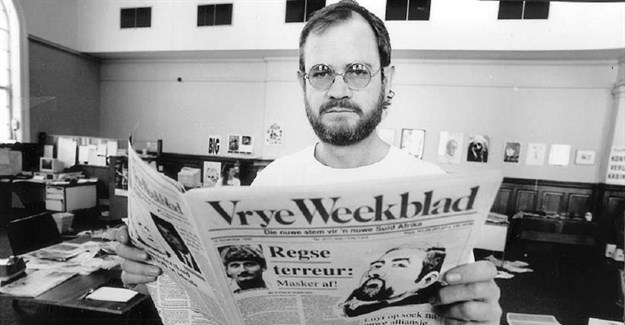 Editor Max du Preez with one of the early editions of Vrye Weekblad. .