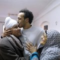 Egyptian photojournalist Mahmoud Abou Zeid, also known as Shawkan, center, is hugged by his parents at his home in Cairo, Egypt, Monday, March 4, 2019. Shawkan was released after five years in prison. Credit: CPJ/AP Photo/Amr Nabil.