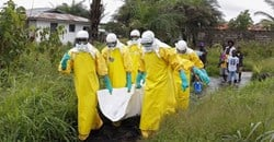 Health workers in Liberia at the height of the 2014-2016 Ebola outbreak. Ahmed Jallanzo/EPA