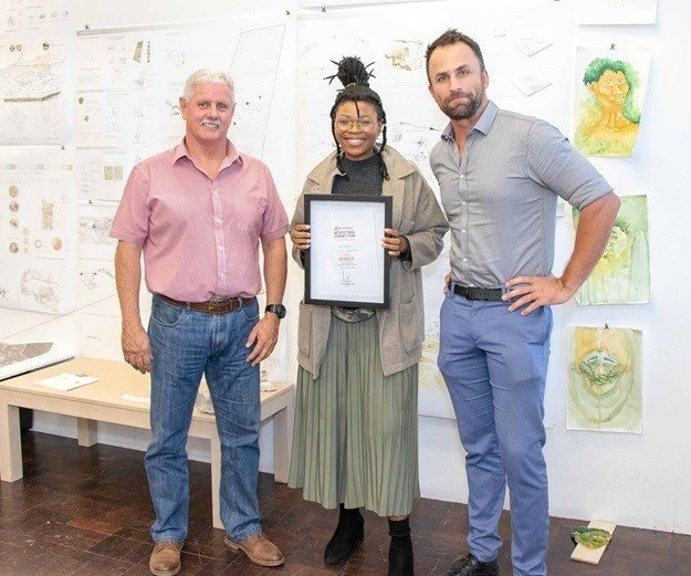 Allin Dangers and Werner Oelofse of Corobrik are pictured with the 2018 winner of the Corobrik Most Innovative Final Year Landscape Architecture Award, Lesego Bantsheng.