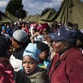 People queue in makeshift camps following past threats of xenophobic attacks in South Africa. Today, rescinded health department memos requesting foreigners pay in full for healthcare have sparked a national debate. (Fredrik Lemeryd)