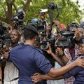 Congolese police officers hold back members of the media in Kinshasa, Democratic Republic of Congo, on January 12, 2019. Journalist Steve Mwanyo Iwewe was recently fined and sentenced to one year in jail for insulting the governor of Équateur province. Credit: CPJ/Jerome Delay/AP.