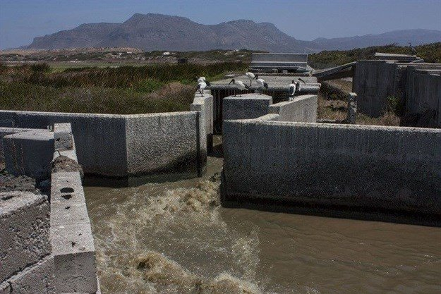 Waste water treatment works such as this one in Strandfontein have been identified as a source of pollution for the Cape Flats Aquifer which is supposed to augment the city's drinking water supply. Photo: Steve Kretzmann/WCN