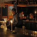A barman using candle light as another rolling blackout affects large parts of South Africa's biggest city, Johannesburg. Epa/Kim Ludbrook