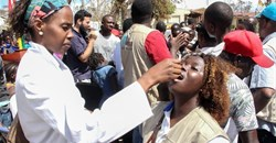 A woman receiving an oral cholera vaccine in Beira, Mozambique. Celeste Mac-Arthur