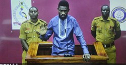 Ugandan pop star and opposition figure Bobi Wine appears for his bail application via a video link from prison, on a television screen in a court in Kampala, Uganda, on May 2, 2019. Uganda's media regulator suspended staff from 13 broadcast outlets for covering his arrest. Credit: CPJ/AP/Ronald Kabuubi.