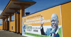 A banner of Tanzanian President John Magufuli hangs on a wall around a tanzanite mine, in April 2018. CPJ and other organizations are calling on the Human Rights Council to address a crackdown on journalists, human rights defenders, and other groups in the country. Credit: CPJ/AFP/Joseph Lyimo.