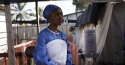 A health worker looks on at an Ebola transit centre in Beni in North Kivu province, DRC. Hugh Kinsella Cunningham/EPA
