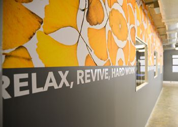 Branding walls and creating floor to ceiling artworks with Canvex