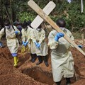 Health workers burying a child who died of Ebola in the DRC's North Kivu province. Hugh Kinsella Cunningham/EPA