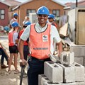 How an NPO helps volunteers to build communities and homes