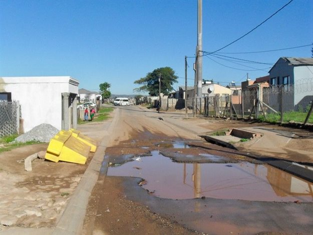 A giant pothole in Ndlambe Street has not been fixed for three years. The question now is can it be fixed before the funds, received in March, have to be returned to Treasury by the end of this month. Photo taken in April by Thamsanqa Mbovane.