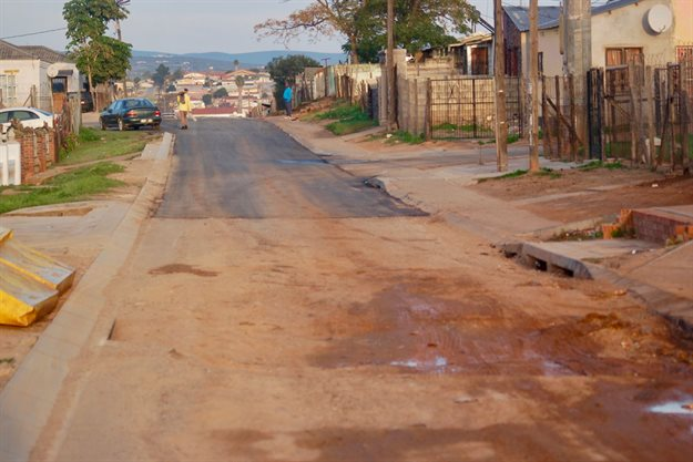 Residents are waiting to see if the giant pothole in Ndlambe Street will be fixed before the end of the month. It was skipped over when the rest of the road was tarred this week. Photo taken in June by Thamsanqa Mbovane.
