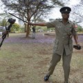 A Kenyan journalist has an altercation with a police officer. EPA/Dai Kurokawa