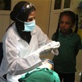 A child about to have his rotten tooth capped at the author's clinic in Khartoum, Sudan. Author provided