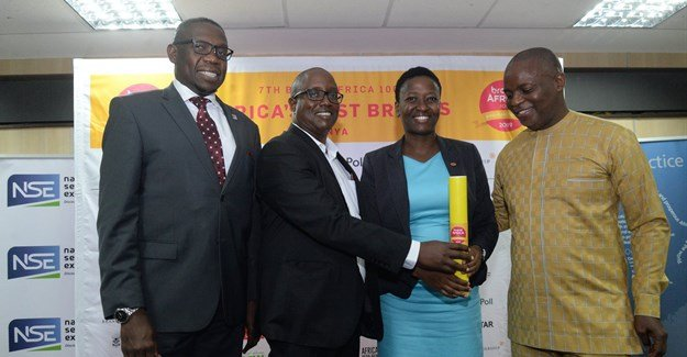 NSE boss Geoffrey Odundo, Brand Integrated partner Richard Mukoma present an award for the most admired brand in the food category in Kenya to Del Monte Kenya marketing manager – Margaret Nyoro, at the Most Admired Brands event at the Exchange in Nairobi. Looking on is Thebe Ikalafeng, founder and chairman of Brand Africa and Brand Leadership – the founders of the annual African survey. Image supplied.