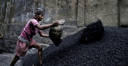 A worker makes coal chips for combustion in Calcutta. India's demand for energy is growing fast. EPA/PIYAL ADHIKARY