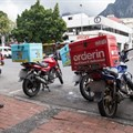 Immigrant food couriers risk death on South African roads