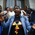 Environmental activists celebrate court ruling against a proposed nuclear deal for South Africa. EPA/Nic Bothma