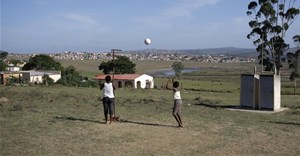 Young girls play netball in an open field near King Williams Town. EPA/Kim Ludbrook