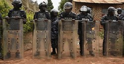 "Ugandan police officers are seen in Kampala on April 23, 2019. Police recently arrested Joseph Kabuleta for allegedly posting ""offensive communication against the person of the President"" online. Credit: CPJ/AFP/Isaac Kasamani."