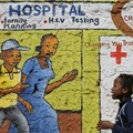 Women walk past a mural painted to raise awareness on HIV and AIDS in Kibera slum in Nairobi, Kenya. EPA/Dai Kurokawa