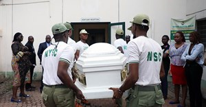 Members of the National Youth Service Corp carry the body of their colleague, the reporter Precious Owolabi, in Abuja on July 23. Owolabi was shot while covering protests in the Nigeria capital. Credit: CPJ/AFP/Kola Sulaimon.