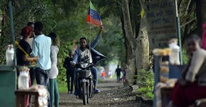 A man rides a motorcycle as young people of the Sidama ethnic group, the largest in southern Ethiopia, celebrate at Hawassa city over plans by local elders to declare the establishment of a breakaway region for the Sidama, in Awasa, July 15, 2019. Authorities arrested three media workers from the Sidama Media Network on July 18. Credit: CPJ/AFP/Michael Tewelde.