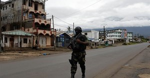 A Cameroonian elite Rapid Intervention Battalion member walks along an empty street in the city of Buea in Cameroon's Anglophone southwest region on October 4, 2018. Cameroon's military detained pidgin news anchor Samuel Wazizi on August 2, 2019, in Buea. Credit: CPJ/Reuters/Zohra Bensemra.