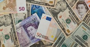 What are the reasons why currency rates fluctuate?