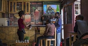 PIC: Ethiopians follow the news on television at a cafe in Addis Ababa, Ethiopia Sunday, June 23, 2019. Ethiopian authorities arrested journalist Mesganaw Getachew on August 9 after he filmed outside a court in Addis Ababa. Credit: CPJ/AP Photo/Mulugeta Ayene.