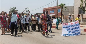 Protesters from two of Benin's unions take part in a demonstration after the parliament approved a law restricting to 10 days public sector employees' right to strike, on September 13, 2018, in Cotonou. Journalist Ignace Sossou convicted of false news in Benin on August 12, 2019. Crdit: CPJ/AFP/Yanick Folly.