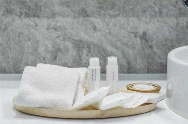 InterContinental Hotels Group is considering flushing their mini-toiletries down the drain and replacing them with bulk items.