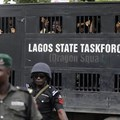 Police officers are seen in Lagos, Nigeria, on August 5, 2019. Lagos police recently arrested publisher Agba Jalingo, who has been charged by federal authorities with treason. Credit: CPJ/AP/Sunday Alamba.
