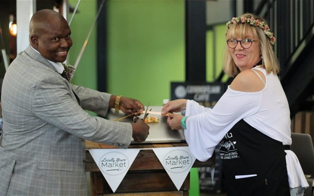Executive Mayor of Nelson Mandela Bay, Cllr Mongameli Bobani, alongside Locally Yours market director Annelize Botha celebrating the official launch of the online store.