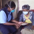 A community care worker providing treatment to a TB patient at her home. Wikkicommons/Stherere23