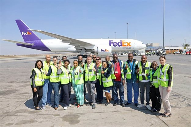 ORTIA team celebrate regularly scheduled FedEx cargo flight