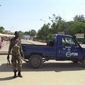 A police officer is seen in N'Djamena, Chad, on July 11, 2015. A N'Djamena court recently charged two Chadian journalists with criminal defamation and sentenced one to jail. Credit: CPJ/Reuters/Moumine Ngarmbassa.