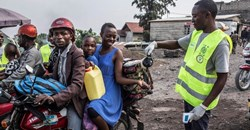 A health worker spreading disinfectant at a health checkpoint in Goma, DRC. Patricia Martinez/EPA-EFE