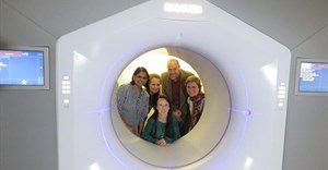 The new Halcyon radiotherapy machine at Groote Schuur hospital. In front is Nanette Joubert, medical physicist. Back from left to right: Dr Bhavna Patel, CEO of the hospital; Dr Bernadette Eick, chief operations officer; Francois Heyns, a patient; and Prof Jeannette Parks; head of radiation oncology. Photo: Elsabé Brits